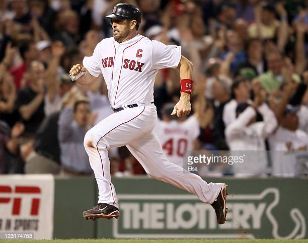 Jason Varitek of the Boston Red Sox heads for home after Jacoby Ellsbury hit a home run in the sixth inning against the New York Yankees on August 31...