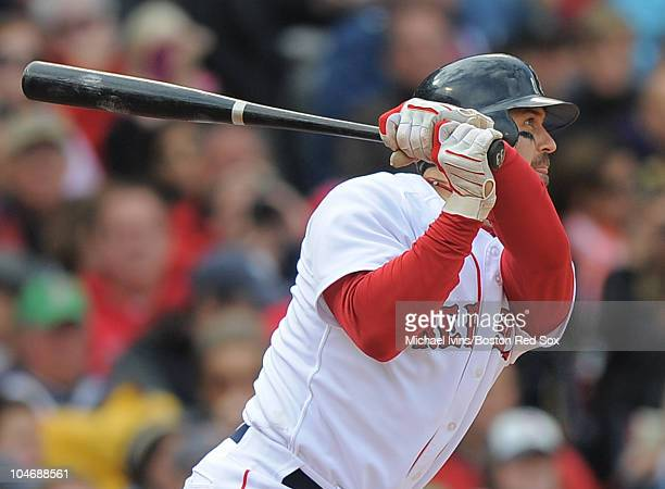 Jason Varitek of the Boston Red Sox hits a single against the New York Yankees in the second inning on October 3 2010 at Fenway Park in Boston...
