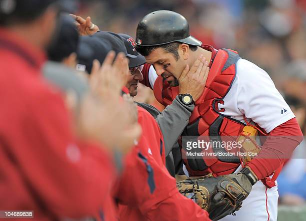 Jason Varitek of the Boston Red Sox hugs manager Terry Francona after being pulled from a game against the New York Yankees in the ninth inning on...