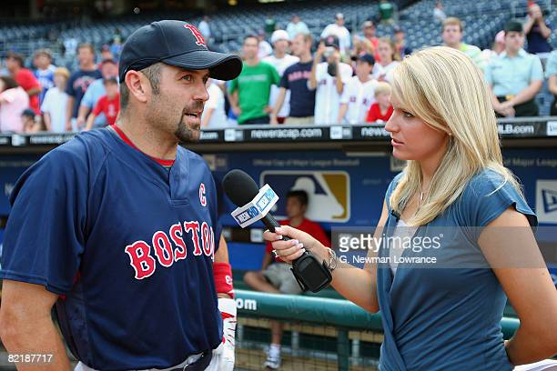 Jason Varitek of the Boston Red Sox is interviewed by NESN reporter Heidi Watney prior to the game against the Kansas City Royals at Kauffman Stadium...