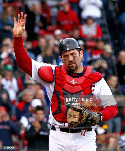 Jason Varitek of the Boston Red Sox reacts to fan applause as he leaves the field for a replacement in the ninth inning against the New York Yankees...