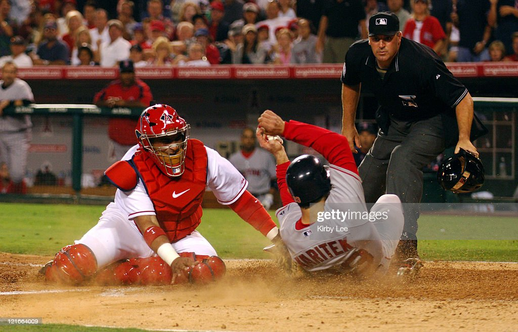 <a gi-track='captionPersonalityLinkClicked' href=/galleries/search?phrase=Jason+Varitek&family=editorial&specificpeople=171480 ng-click='$event.stopPropagation()'>Jason Varitek</a> of the Boston Red Sox slides safety beneath tag of Los Angeles Angels of Anaheim catcher <a gi-track='captionPersonalityLinkClicked' href=/galleries/search?phrase=Bengie+Molina&family=editorial&specificpeople=167095 ng-click='$event.stopPropagation()'>Bengie Molina</a> to score in the fifth inning of 4-3 victory in 10 innings over the Los Angeles Angels of Anaheim at Angel Stadium in Anaheim, Calif. on Friday, August 19, 2005.