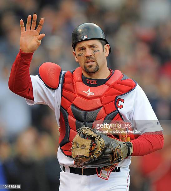 Jason Varitek of the Boston Red Sox waves to the crowd after being pulled from a game against the New York Yankees in the ninth inning on October 3...