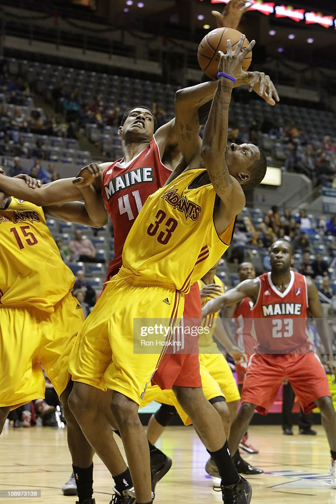 Jason Warren #33 of the Fort Wayne Mad Ants battles Fab Melo #41 of the Maine Red Claws at Allen County Memorial Coliseum on November 25, 2010 in Fort Wayne, Indiana.