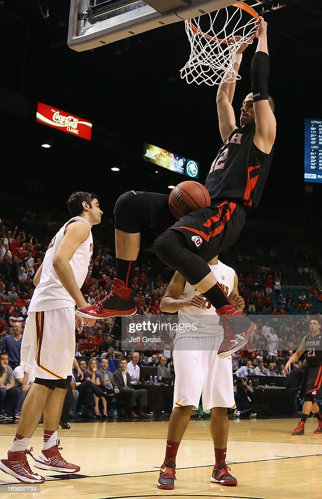 Jason Washburn #42 of the Utah Utes dunks the ball against the USC Trojans in the second half during the first round of the Pac 12 Tournament at the MGM Grand Garden Arena on March 13, 2013 in Las Vegas, Nevada. Utah defeated USC