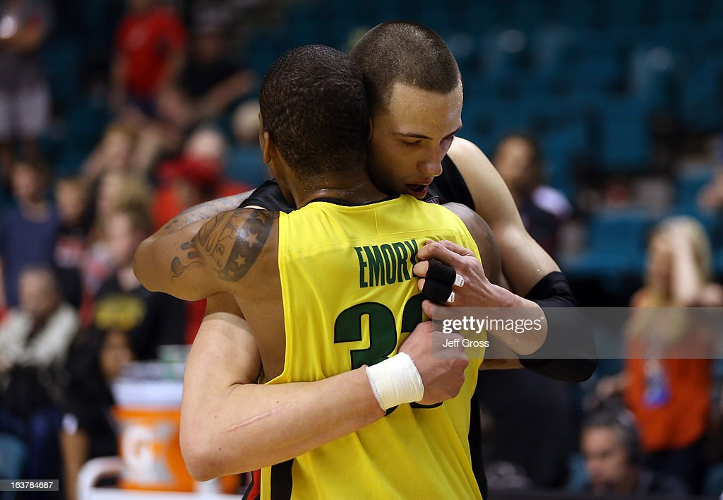Jason Washburn #42 of the Utah Utes hugs Carlos Emory #33 of the Oregon Ducks after the Ducks victory during the semifinals of the Pac-12 tournament at the MGM Grand Garden Arena on March 14, 2013 in Las Vegas, Nevada.