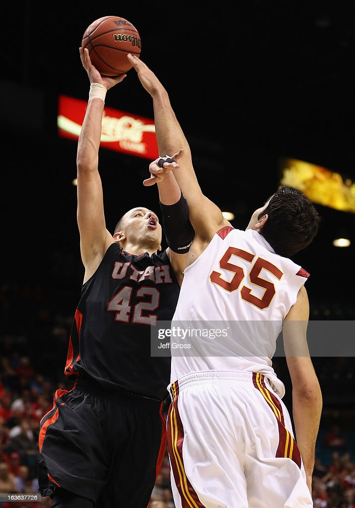 Jason Washburn #42 of the Utah Utes shoots over Omar Oraby #55 of the USC Trojans in the second half during the first round of the Pac 12 Tournament at the MGM Grand Garden Arena on March 13, 2013 in Las Vegas, Nevada. Utah defeated USC