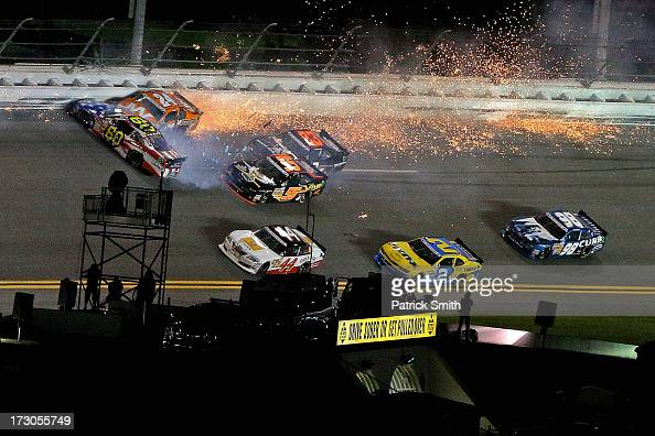 Jason White driver of the JW Demolition Toyota and Travis Pastrana driver of the Roush Fenway Racing / RaceTrac Ford are involved in an incident...