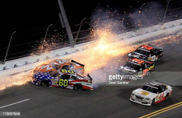 Jason White driver of the JW Demolition Toyota crashes into Travis Pastrana driver of the Roush Fenway Racing / RaceTrac Ford during the NASCAR...
