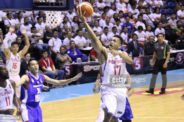 Jason William of the Philippines leaves his guards from Thailand converting an open layup Philippines drubs Thailand 10853 during their match at the...