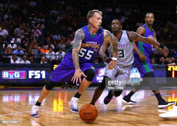 Jason Williams of the 3 Headed Monsters controls the ball against Marcus Banks of the Ghost Ballers during week one of the BIG3 three on three...