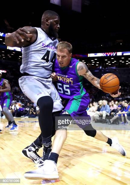 Jason Williams of the 3 Headed Monsters drives to the basket against Ivan Johnson of the Ghost Ballers during week one of the BIG3 three on three...