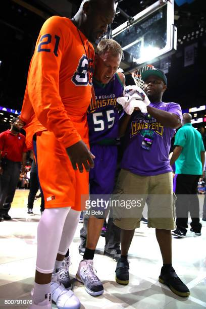 Jason Williams of the 3 Headed Monsters is helped off the floor after an injury in the game against the Ghost Ballers during week one of the BIG3...