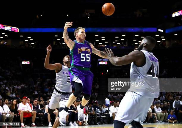 Jason Williams of the 3 Headed Monsters passes against Ivan johnson of the Ghost Ballers during week one of the BIG3 three on three basketball league...
