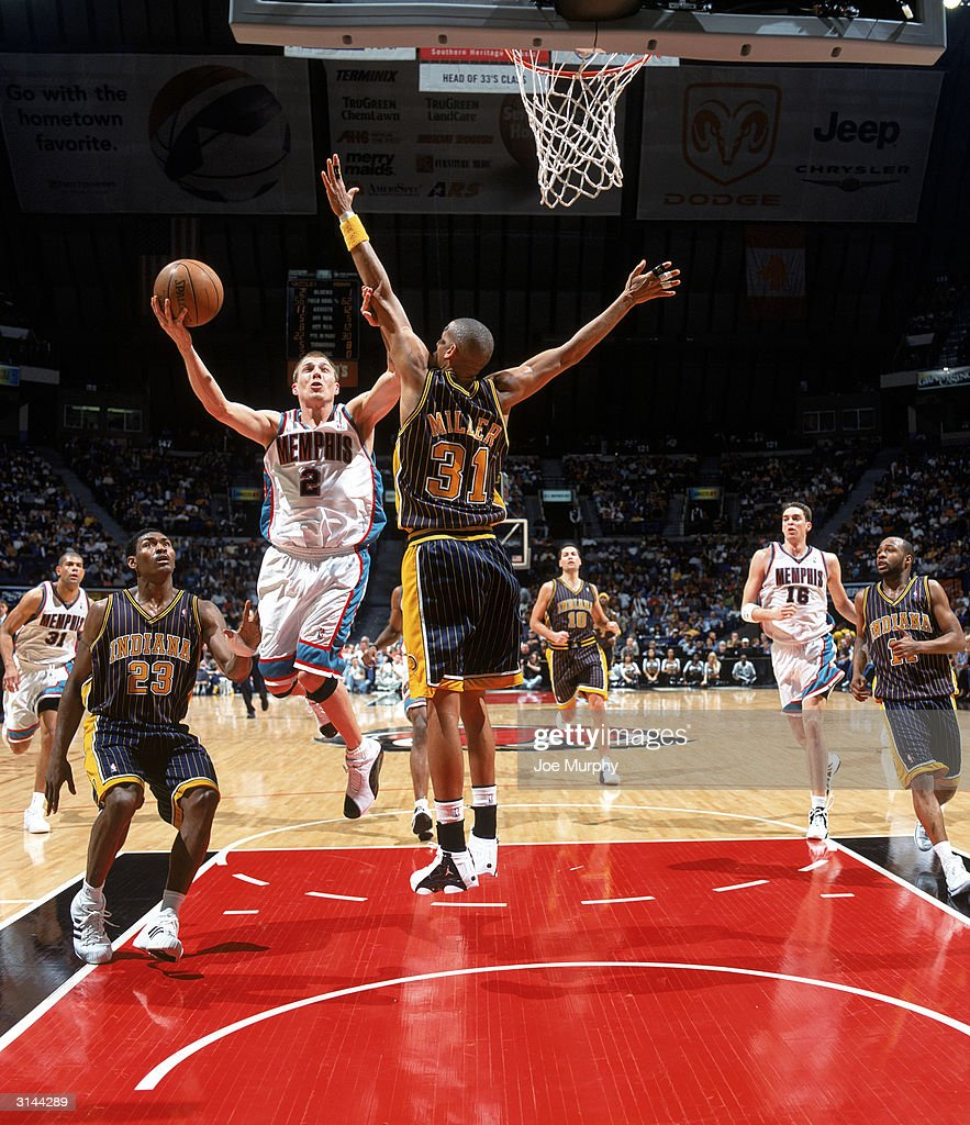 Jason Williams of the Memphis Grizzlies drives to the basket against Reggie Miller of the Indiana Pacers during the game at The Pyramid on March 20...