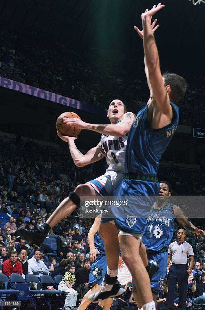 Jason Williams #2 of the Memphis Grizzlies goes up for the shot against Radoslav Nesterovic #8 of the Minnesota Timberwolves during the NBA game at The Pyramid on November 15, 2002 in Memphis, Tennessee. The Timberwolves won 99-95.