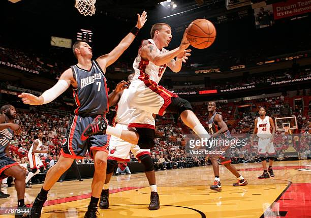 Jason Williams of the Miami Heat passes against Primoz Brezec of the Charlotte Bobcats at the American Airlines Arena November 4 2007 in Miami...