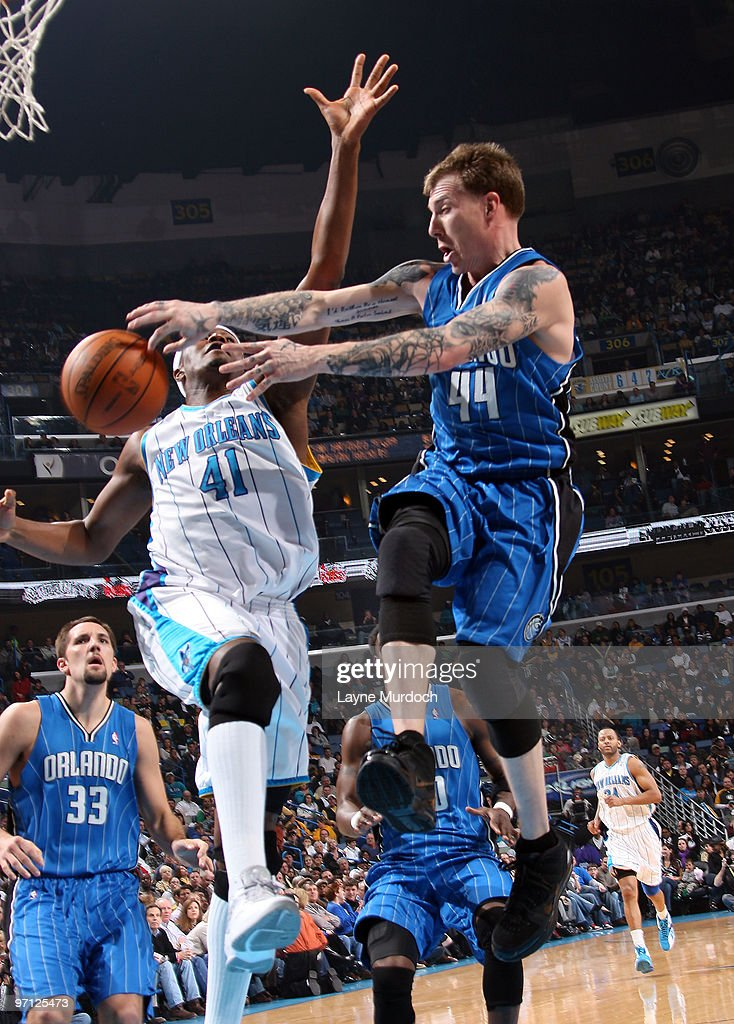 67ac25bf8 ... real jersey jason williams 44 of the orlando magic passes around james  posey 41 of the