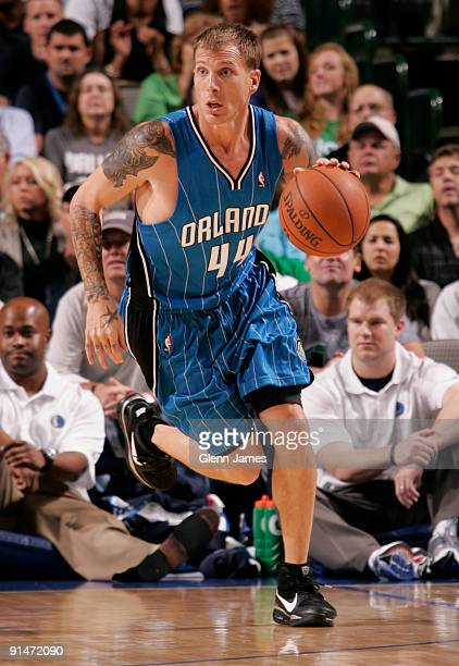 Jason Williams of the Orlando Magic pushes the ball up the court against the Dallas Mavericks in preseason action at the American Airlines Center on...
