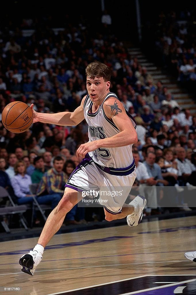 Jason Williams #55 of the Sacramento Kings drives to the basket during the NBA game circa 1999 in Sacramento, California.