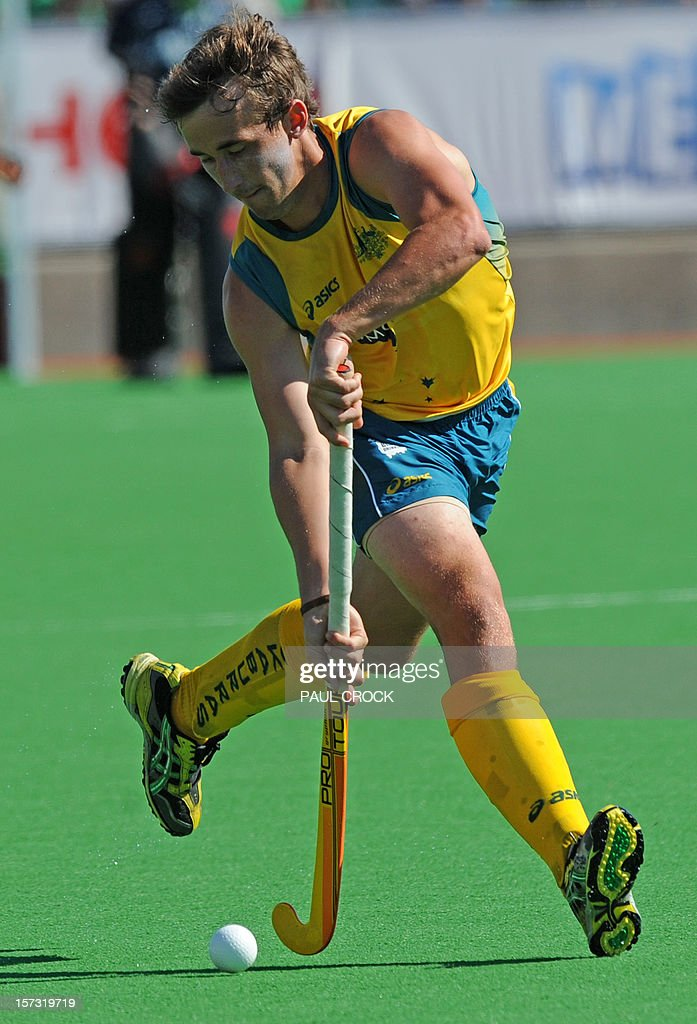 Jason Wilson of Australia takes a run down the pitch during the Pool B match against the Netherlands at the Men's Hockey Champioships Trophy in Melbourne on December 2, 2012. IMAGE STRICTLY RESTRICTED TO EDITORIAL USE - STRICTLY NO COMMERCIAL USE AFP PHOTO/Paul CROCK