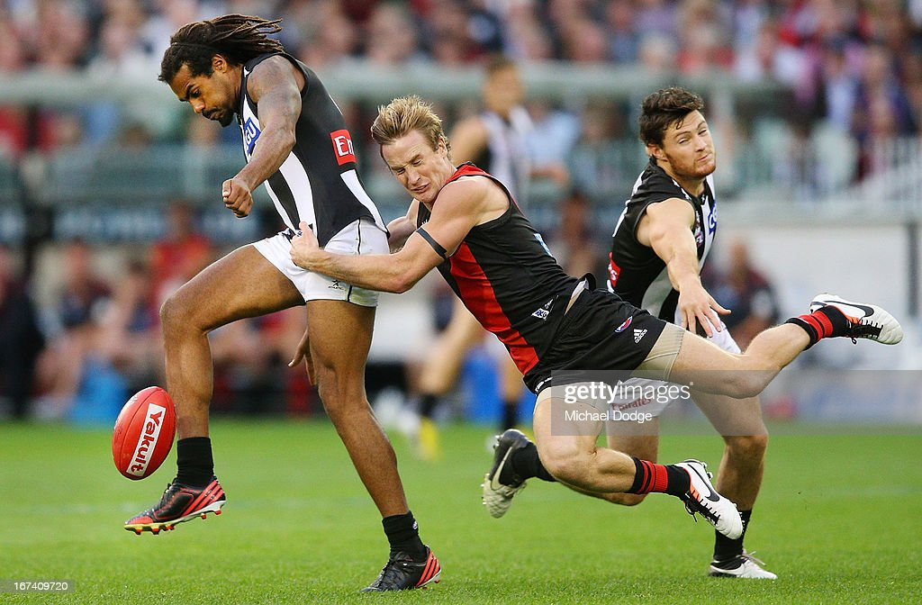 Jason Winderlich of the Bombers tackles Harry O'Brien of the Magpies during the round five AFL match between the Essendon Bombers and the Collingwood Magpies at Melbourne Cricket Ground on April 25, 2013 in Melbourne, Australia.