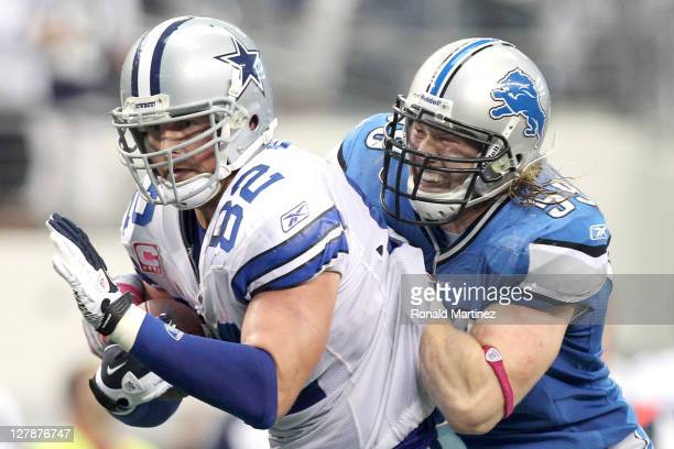 Jason Witten of the Dallas Cowboys carries the ball against Bobby Carpenter of the Detroit Lions during the second half at Cowboys Stadium on October...