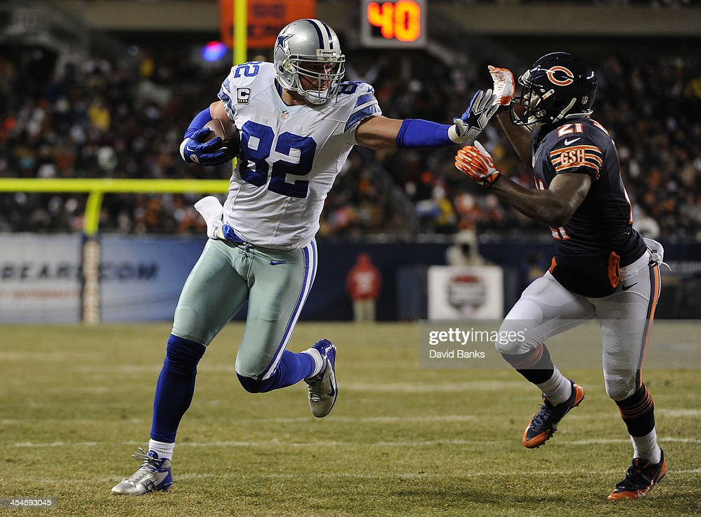 <a gi-track='captionPersonalityLinkClicked' href=/galleries/search?phrase=Jason+Witten&family=editorial&specificpeople=212871 ng-click='$event.stopPropagation()'>Jason Witten</a> #82 of the Dallas Cowboys catches a touchdown pass as he's defended by <a gi-track='captionPersonalityLinkClicked' href=/galleries/search?phrase=Major+Wright&family=editorial&specificpeople=4500972 ng-click='$event.stopPropagation()'>Major Wright</a> #21 of the Chicago Bears during the second quarter on December 9, 2013 at Soldier Field in Chicago, Illinois.