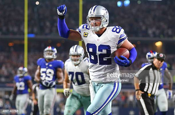 Jason Witten of the Dallas Cowboys celebrates after catching a touchdown pass in the fourth quarter as the Cowboys take on the New York Giants at ATT...