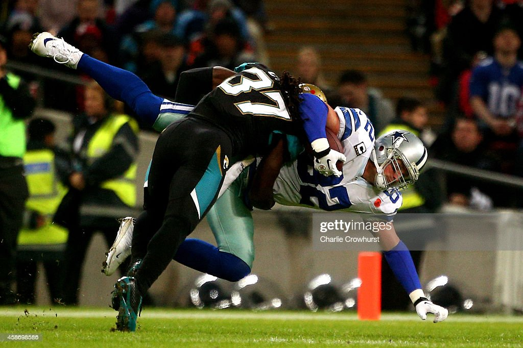 Jason Witten #82 of the Dallas Cowboys is tackled by Johnathan Cyprien #37 of the Jacksonville Jaguars during the NFL week 10 match between the Jackson Jaguars and the Dallas Cowboys at Wembley Stadium on November 9, 2014 in London, England.