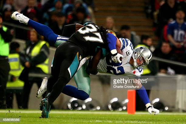 Jason Witten of the Dallas Cowboys is tackled by Johnathan Cyprien of the Jacksonville Jaguars during the NFL week 10 match between the Jackson...