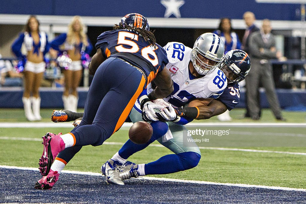 <a gi-track='captionPersonalityLinkClicked' href=/galleries/search?phrase=Jason+Witten&family=editorial&specificpeople=212871 ng-click='$event.stopPropagation()'>Jason Witten</a> #82 of the Dallas Cowboys misses a touchdown pass while being defended by <a gi-track='captionPersonalityLinkClicked' href=/galleries/search?phrase=Duke+Ihenacho&family=editorial&specificpeople=6241776 ng-click='$event.stopPropagation()'>Duke Ihenacho</a> #33 and <a gi-track='captionPersonalityLinkClicked' href=/galleries/search?phrase=Nate+Irving&family=editorial&specificpeople=4753462 ng-click='$event.stopPropagation()'>Nate Irving</a> #56 of the Denver Broncos at AT&T Stadium on October 6, 2013 in Arlington, Texas. The Broncos defeated the Cowboys 51-48.