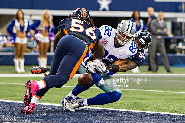 Jason Witten of the Dallas Cowboys misses a touchdown pass while being defended by Duke Ihenacho and Nate Irving of the Denver Broncos at ATT Stadium...