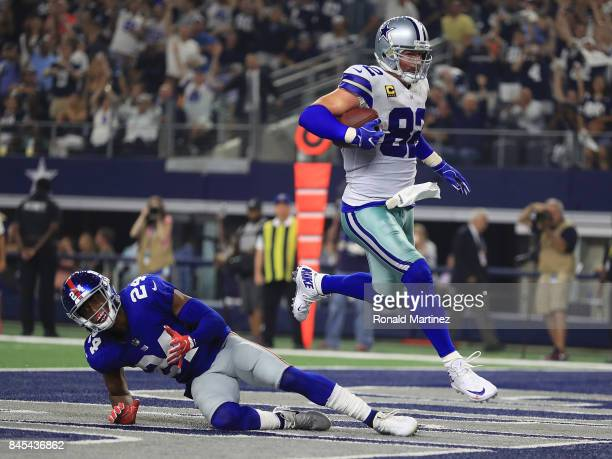 Jason Witten of the Dallas Cowboys scores a touchdown over Eli Apple of the New York Giants inthe first half of a game at ATT Stadium on September 10...