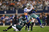 Jason Witten of the Dallas Cowboys tries to break the tackle of Patrick Chung of the Philadelphia Eagles in the second half at Cowboys Stadium on...