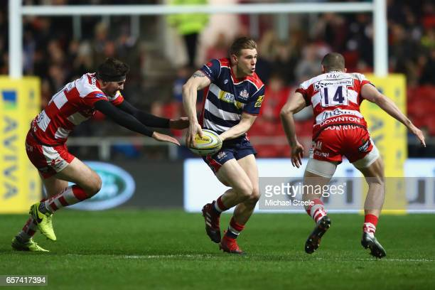 Jason Woodward of Bristol looks to pass as Andy Symons and Jonny May of Gloucester close in during the Aviva Premiership match between Bristol Rugby...