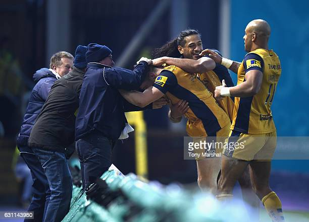 Jason Woodward of Bristol Rugby celebrates scoring a try with fans during the Aviva Premiership match between Northampton Saints and Bristol Rugby at...