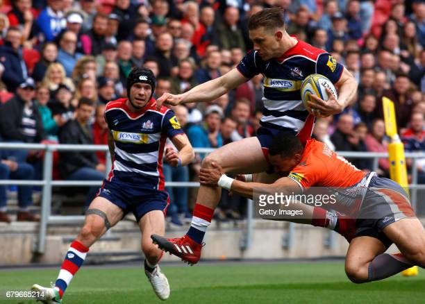 Jason Woodward of Bristol Rugby is tackled by MarcusWatson of Newcastle Falcons during the Aviva Premiership match between Bristol Rugby and...