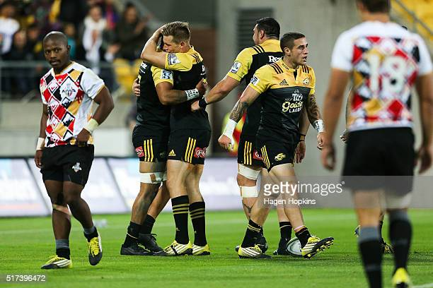Jason Woodward of the Hurricanes congratulates Ardie Savea on his try during the round five Super Rugby match between the Hurricanes and the Kings at...