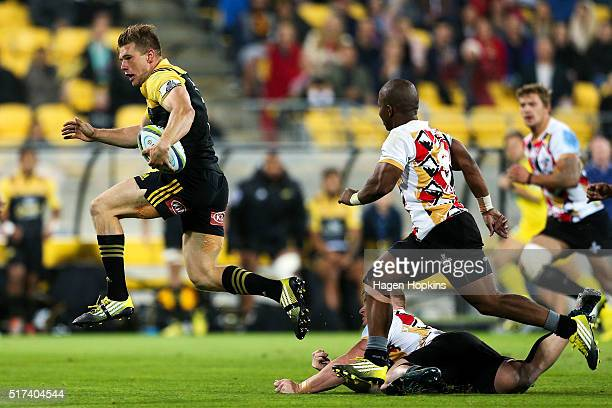 Jason Woodward of the Hurricanes makes a break from Ntando Kebe of the Kings during the round five Super Rugby match between the Hurricanes and the...