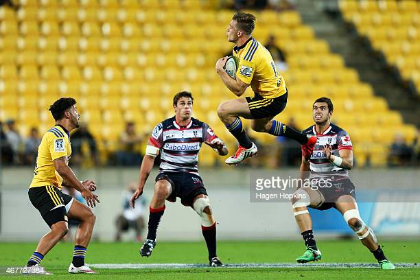 Jason Woodward of the Hurricanes takes a high ball during the round seven Super Rugby match between the Hurricanes and the Rebels at Westpac Stadium...