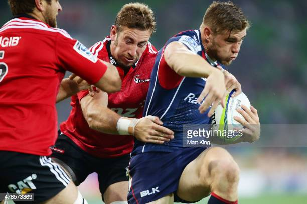 Jason Woodward of the Rebels takes on the defence during the round five Super Rugby match between the Melbourne Rebels and the Crusaders at AAMI Park...