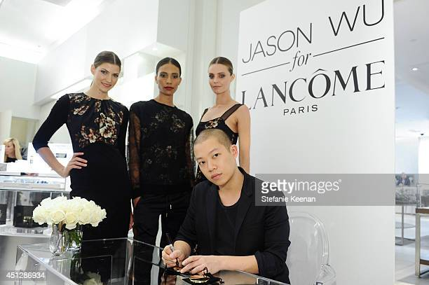 Jason Wu and models attend Saks Fifth Avenue Presents Limited Edition Jason Wu For Lancome PreFall 2014 Collection at Saks Fifth Avenue on June 26...