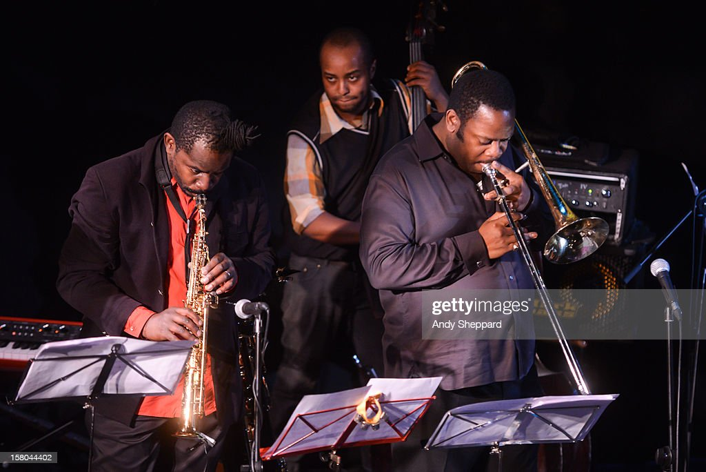 Jason Yarde, Neil Charles and Harry Brown perform for the Jazz in the Round 2012 Christmas Special at The Cockpit Theatre on December 9, 2012 in London, England.