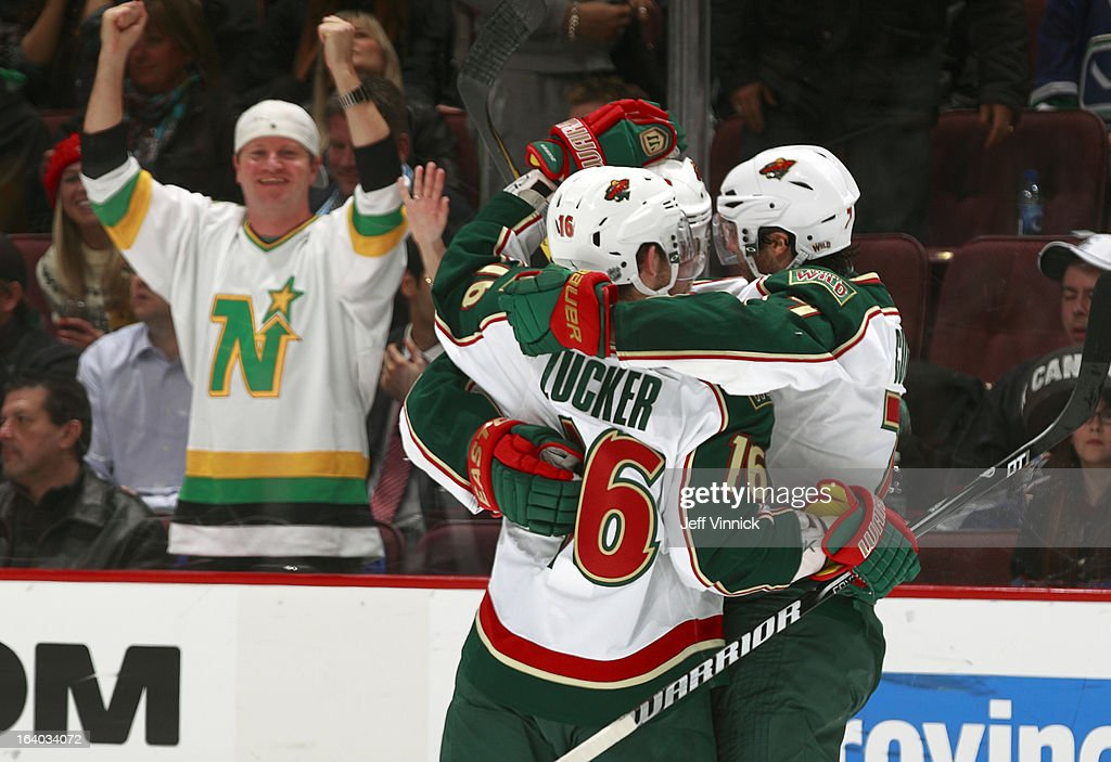Jason Zucker #16 leads a celebration of a Minnesota Wild goal against the Vancouver Canucks during their NHL game at Rogers Arena March 18, 2013 in Vancouver, British Columbia, Canada.