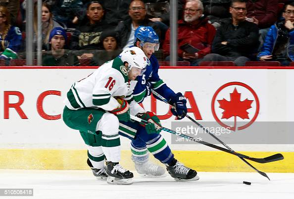 Jason Zucker of the Minnesota Wild and Luca Sbisa of the Vancouver Canucks battle for the puck during their NHL game at Rogers Arena February 15 2016...