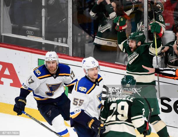 Jason Zucker of the Minnesota Wild celebrates his gametying goal as Jaden Schwartz and Colton Parayko of the St Louis Blues look on during the third...