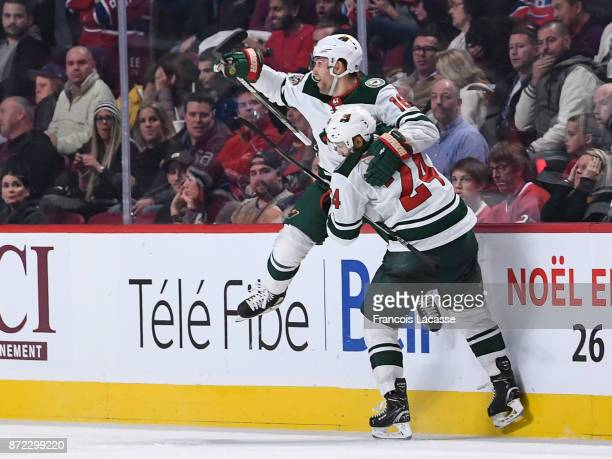 Jason Zucker of the Minnesota Wild celebrates with Matt Dumba after scoring a goal against the Montreal Canadiens in the NHL game at the Bell Centre...