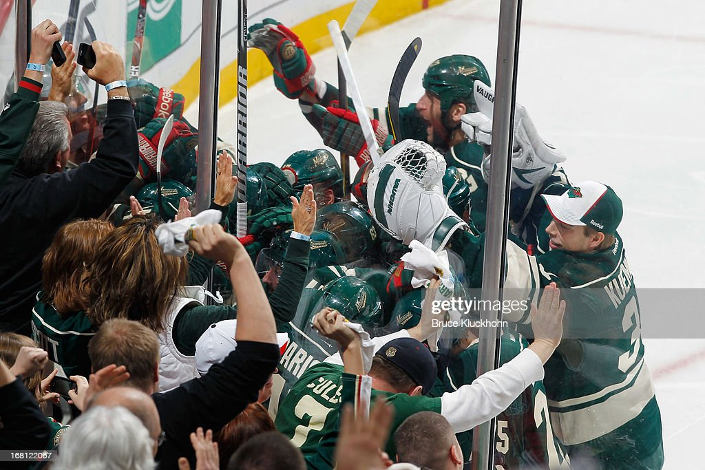 Jason Zucker #16 of the Minnesota Wild is mobbed by his teammates after scoring the game winning goal in overtime against the Chicago Blackhawks during Game Three of the Western Conference Quarterfinals during the 2013 NHL Stanley Cup Playoffs on May 5, 2013 at the Xcel Energy Center in St. Paul, Minnesota.