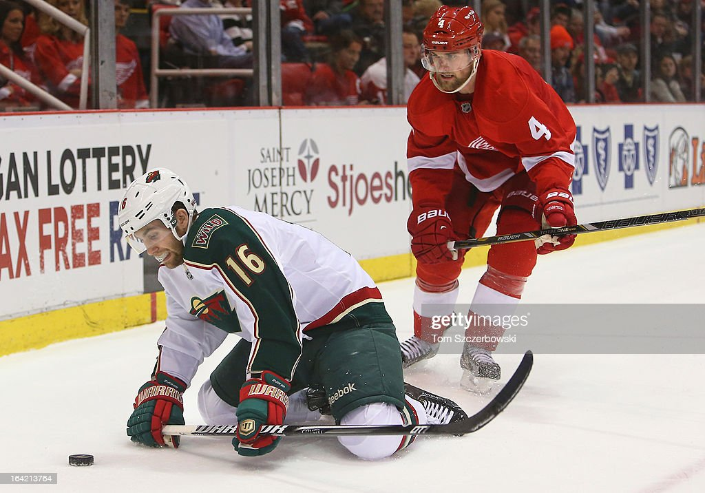 Jason Zucker #16 of the Minnesota Wild is sent to the ice by <a gi-track='captionPersonalityLinkClicked' href=/galleries/search?phrase=Jakub+Kindl&family=editorial&specificpeople=716743 ng-click='$event.stopPropagation()'>Jakub Kindl</a> #4 of the Detroit Red Wings during their NHL game at Joe Louis Arena on March 20, 2013 in Detroit, Michigan.